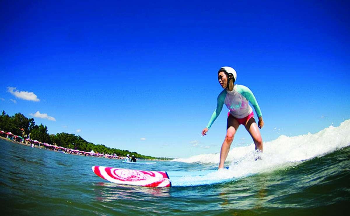 Surfing in Sanur Beach
